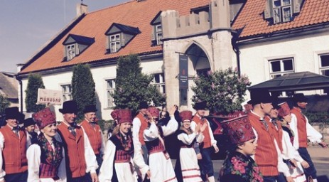A parade of locals in traditional costumes, Kuresaare,