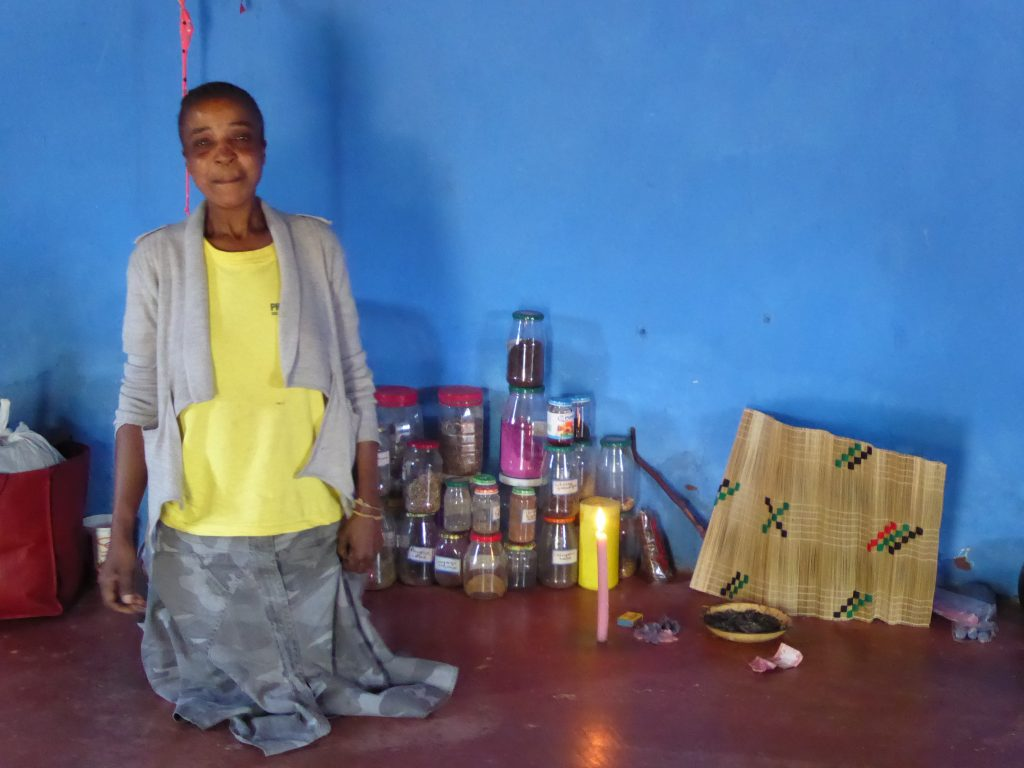 Speaking with the township's traditional healer
